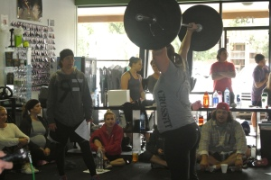 14.1 in action with Melissa and Aaron cheering and coaching her on.