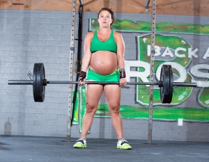 HARD TO BELIEVE THIS WAS MORE THAN A YEAR AGO ***EXCLUSIVE*** PHOENIX, ARIZONA - APRIL 26: Meghan Leatherman, 33, is nine months pregnant and dilated to 1cm seen lifting a heavy weight at her home town gym on April 26, 2014 in Phoenix, Arizona. The 33-year-old even lifted weights on the day she went into labor and broke records in the final days of pregnancy. PHOTOGRAPH BY Dave Cruz / Barcroft Media