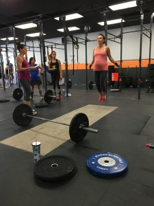 Coach Luz coaching me through one of the CrossFit Open WODs at Full Strength.